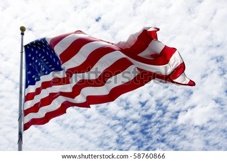 United States flag waving in the wind with beautiful sky in background