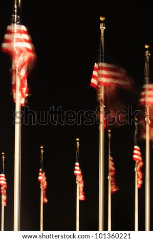 United States flags at night at the Washington Monument.