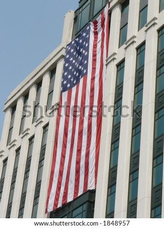 United States flags, hung during a sunny day, on the front side of buildings in Arlington, VA as a memorial to pay tribute to the victims and heros of 9-11.