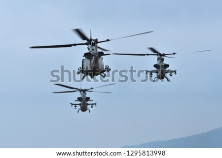 United States Marines helicopter fly in formation.