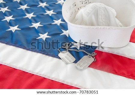united states navy hat and dog tags