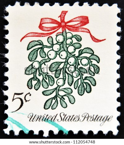 UNITED STATES OF AMERICA - CIRCA 1964: A Christmas postage stamp printed in USA shows mistletoe, circa 1964