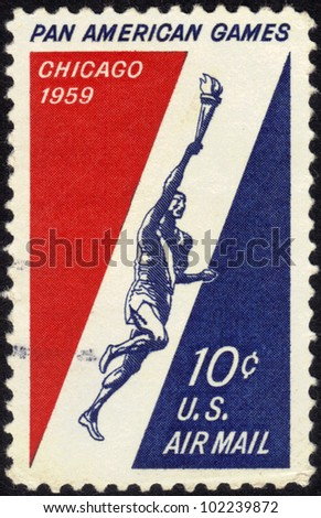 UNITED STATES OF AMERICA - CIRCA 1959: A stamp printed in the United States of America shows Runner Holding Torch, 3rd Pan American Games, Chicago, circa 1959