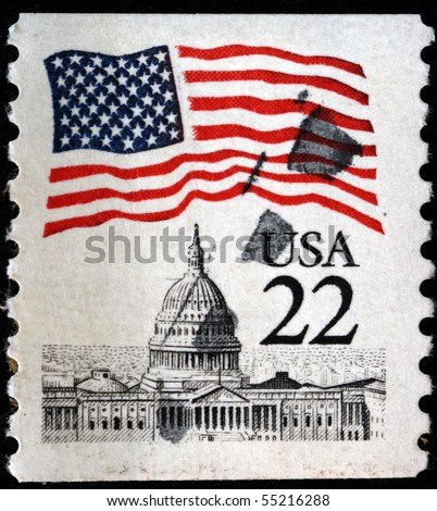 UNITED STATES OF AMERICA - CIRCA 1985: A stamp printed in the USA shows Flag over Capitol, circa 1985