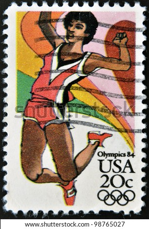 UNITED STATES OF AMERICA - CIRCA 1984: A stamp printed in USA from the Los Angeles Olympics 1984 issue, showing long jump, circa 1984. - stock photo