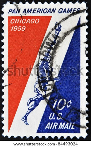 UNITED STATES OF AMERICA - CIRCA 1959: A stamp printed in USA shows athlete with the Olympic flame, the start of the pan american Games in Chicago, circa 1959