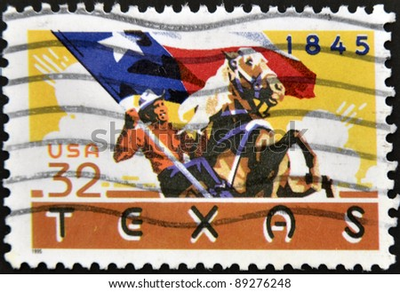 UNITED STATES OF AMERICA - CIRCA 1995: A stamp printed in USA shows Cowboy on horseback carrying Texas flag, circa 1995