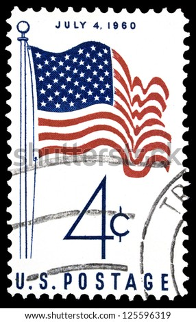 "UNITED STATES OF AMERICA - CIRCA 1960: A stamp printed in USA shows U.S. Flag, with inscription ""July 4, 1960"", series ""America, 50 - Star Flag Issue"", circa 1960"