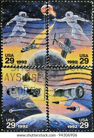 UNITED STATES OF AMERICA - CIRCA 1992: A stamp printed in USA to commemorate the achievements in space of both the USA and Russia - stock photo