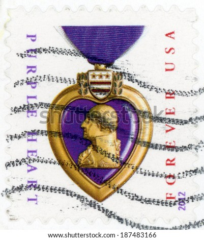 UNITED STATES OF AMERICA - CIRCA 2012: first class forever post stamp printed in US shows purple heart medal on ribbon; honors veterans sacrifices served in US military; purple gold; circa 2012