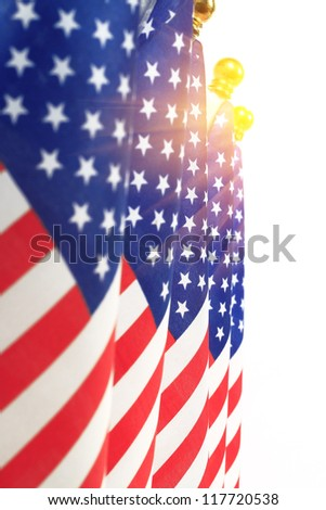 United States of America flags hanging on the gold flagpole,Isolated on the white background