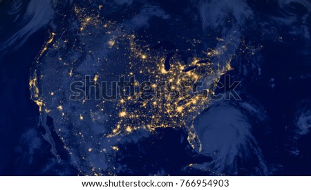 United States of America lights during night as it looks like from space. Elements of this image are furnished by NASA #766954903