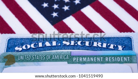 United states of America Permanent Resident  (Green card) and Social security number (SSN) cards on USA Flag background. #1041519490