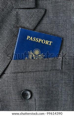United States of America US citizenship passport book in an American executive business man suit jacket breast pocket for a corporate trip abroad