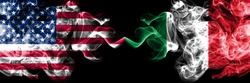 United States of America vs Italy, Italian smoky mystic flags placed side by side. Thick colored silky smoke flags of America and Italy, Italian.