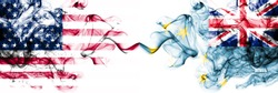 United States of America vs Tuvalu, Tuvaluan smoky mystic flags placed side by side. Thick colored silky abstract smokes banner of America and Tuvalu, Tuvaluan