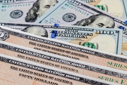 Unites States of America government savings bond series EE with 100 dollar bills