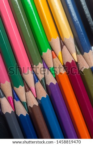 Unity and diversity. Still Life Conceptual - Colored Pencils on isolated backround. Unity and diversity. Still Life Conceptual - Colored Pencils on isolated backround. Shallow depth of field