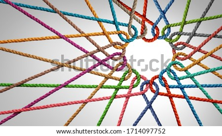 Unity and love partnership as ropes shaped as a heart in a group of diverse strings connected together shaped as a support symbol expressing the feeling of teamwork and togetherness.