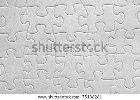 Unity:blank grey jigsaw puzzle pieces all connected, great details of textured cardboard material