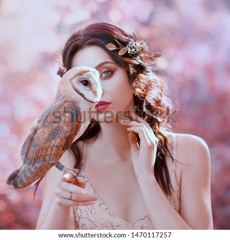 unity with nature, portrait photography of cute girl with fair skin and white owl, lady with wavy black hair in beige shiny dress hides half her face, gold flowers in hair, pink delicate shades #1470117257