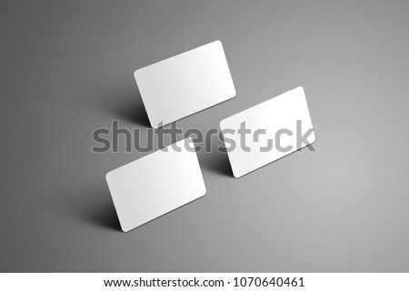 Universal  blank template of a three bank gift cards with shadows on a gray background. Black and white mockup ready to used in your design.