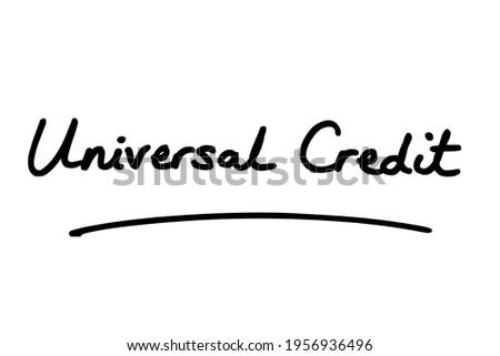 Universal Credit, handwritten on a white background. Foto stock ©