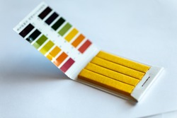 Universal Litmus pH test and color scale on white