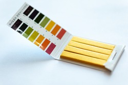 Universal Litmus pH test and color scale on white background