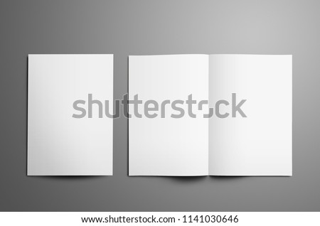 Universal tempalte with two white  A4, (A5) bi-fold brochures with realistic  shadows isolated on gray background. One booklet is closed the second is open on the spread.  Top of view.