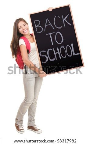 University college student showing blackboard / chalkboard saying back to school. Beautiful mixed race Asian Caucasian young female model. Isolated in full length on white background.