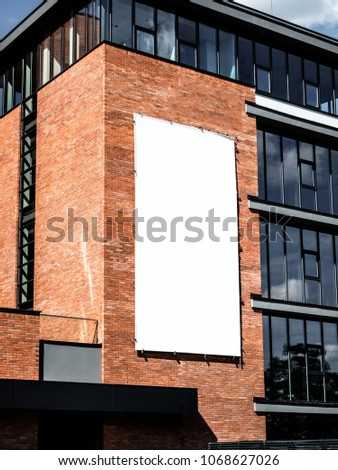 University, company office building facade, Blank white paper board at grunge brick red wall texture background, Mock up ads template, Business presentation content concept. #1068627026