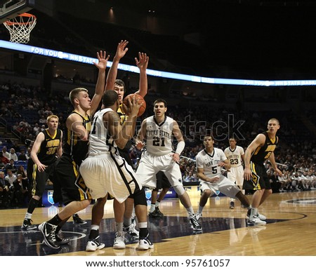 UNIVERSITY PARK, PA - FEB 16: Iowa's defense collapses on Penn State's Jermaine Marshall during a game at the Byrce Jordan Center on February 16, 2012 in University Park, PA