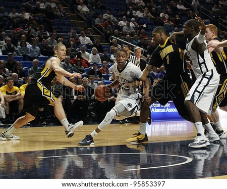 UNIVERSITY PARK, PA - FEB 16: Penn State's Tim Frazier drives to the basket against Iowa at the Byrce Jordan Center on February 16, 2012 in University Park, PA