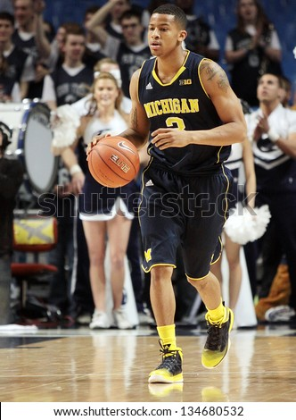 UNIVERSITY PARK, PA - February 27: Michigan\'s Trey Burke dribbles the basketball up the court during  a game against Penn State at the Byrce Jordan Center February 27, 2013 in University Park, PA