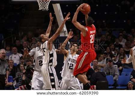 UNIVERSITY PARK, PA - FEBRUARY 24: Ohio State guard Evan Turner shoots over Penn State defenders, D.J. Jackson and Talor Battle #12 at the Byrce Jordan Center February 24, 2010 in University Park, PA