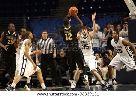 UNIVERSITY PARK, PA - JANUARY 5: Penn State's Billy Oliver defends as Purdue's  Kelsey Barlow No. 12 shoots at the Byrce Jordan Center on January 5, 2011 in University Park, PA