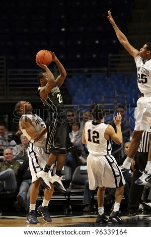 UNIVERSITY PARK, PA - JANUARY 5: Purdue\'s point guard Lewis Jackson looks to shoot as Penn State\'s Jeff Brooks defends the basket at the Byrce Jordan Center on January 5, 2011 in University Park, PA