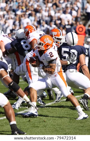 UNIVERSITY PARK, PA - OCT 9: Illinois quarterback No. 2, Nathan Scheelhaase runs between the tackles against Penn State at Beaver Stadium on October 9, 2010 in University Park, PA
