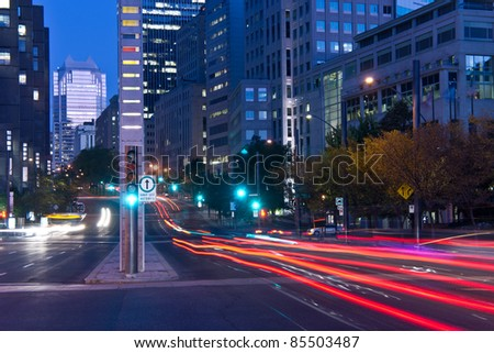 University Street in Montreal with silhouette cars with red rear light and traffic light, early morning to dusk. # 1