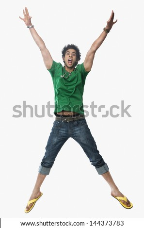 University student jumping with arms raised - stock photo