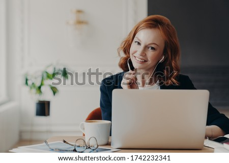 University student studies online from home, discusses project work with professor, poses in coworking space and drinks aromatic coffee. Video conference, vitrual event, online education concept