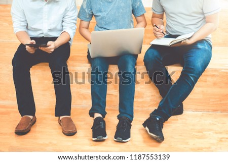 University students using laptop meeting for research homework in college
