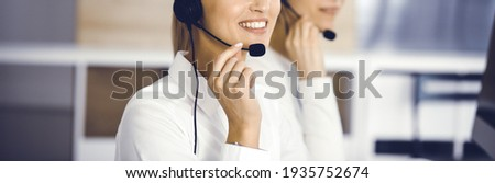 Unknown female customer service representative is consulting clients online using headset.close-up. Call center and business concept