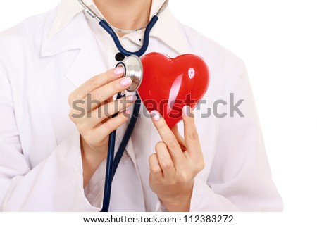 Unknown female doctor standing with stethoscope and red heart symbol isolated on white background