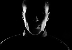 Unknown  male person silhouette.Back lit studio isolated
