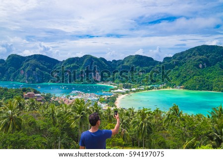 Unknown Man Take a Photo at the top view of Phi Phi Island at Phuket Bangkok,Thailand - Shutterstock ID 594197075