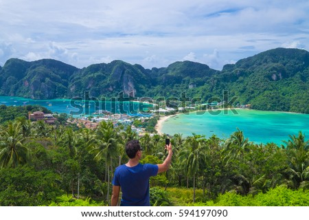 Unknown Man Take a Photo at the top view of Phi Phi Island at Phuket Bangkok,Thailand - Shutterstock ID 594197090