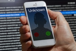unknown unwanted call to a mobile phone on a dark background
