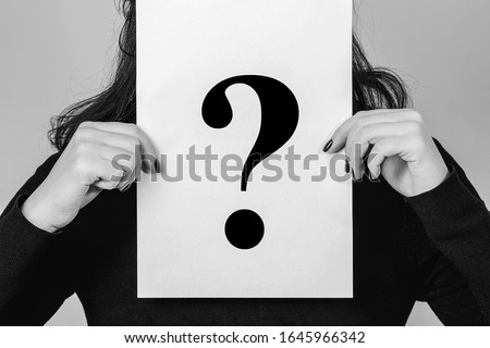 Unknown woman holding question mark. Female problems and stress. Girl holding paper question mark. Anonymous, woman question, incognita. Problems and solutions. Question mark. Bullying on a work.